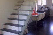 Fully frameless glass rail with standoff